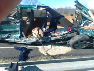 Picture taken by Hugh McGee at the scene of the accident.  It is of my drivers' side, direct impact of accident, Juno was sitting at the point of direct impact as was I.
